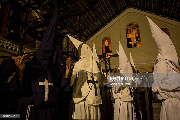 Penitents watch on from a damaged part of the Palo Cathedral during the Maundy Thursday mass at Palo Cathedral on April 17 2014 in Palo Leyte...