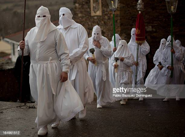 Penitents wearing capirote start their Holy Week procession of the Cofradia of Santo Entierro brotherhood on March 29 2013 in Bercianos de Aliste...