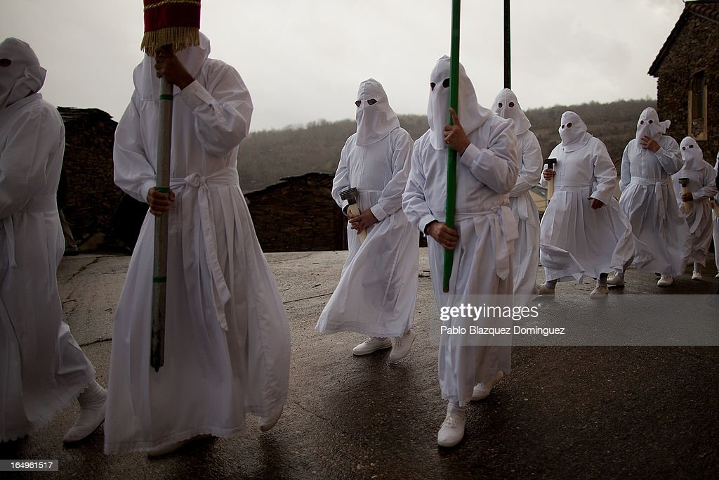 Penitents wearing capirote start their Holy Week procession of the Cofradia of Santo Entierro brotherhood on March 29, 2013 in Bercianos de Aliste near Zamora, Spain. The procession was finally stopped because of the rain. Easter week is traditionally celebrated with processions in most Spanish towns.