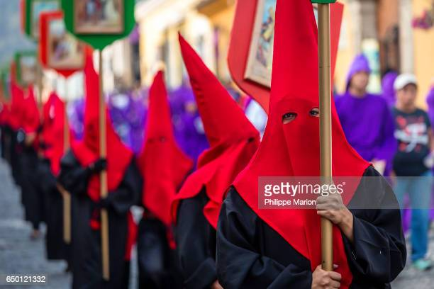 Penitents wearing hoods in procession during Holy Week (Semana Santa) - Antigua Guatemala