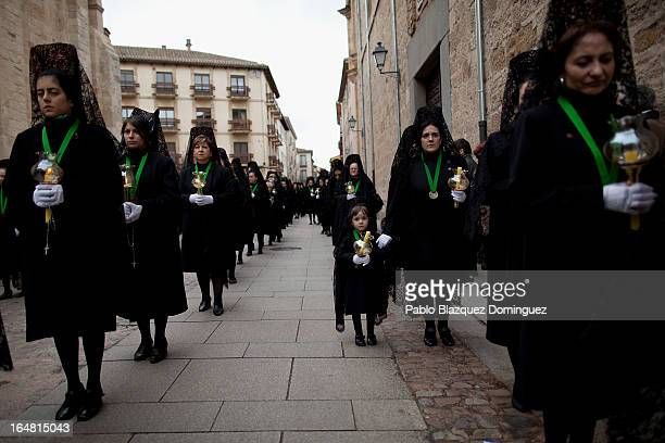 Penitents wearing mantillas walk the streets during the Holy Week procession of the Cofradia de la Virgen de la Esperanza on March 28 2013 in Zamora...