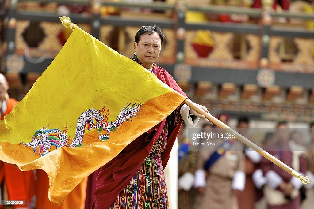 Penjor, Personal Secretary to His Majesty King Jigme Khesar Namgyel Wangchuck carries the national flag of Bhutan at the Chang Lime Thang stadium on October 15, 2011 in Thimphu, Bhutan. In this final day of wedding celebrations for the royal wedding, more than 50,000 people turned up at the stadium with about 500 performers to entertain the guests.