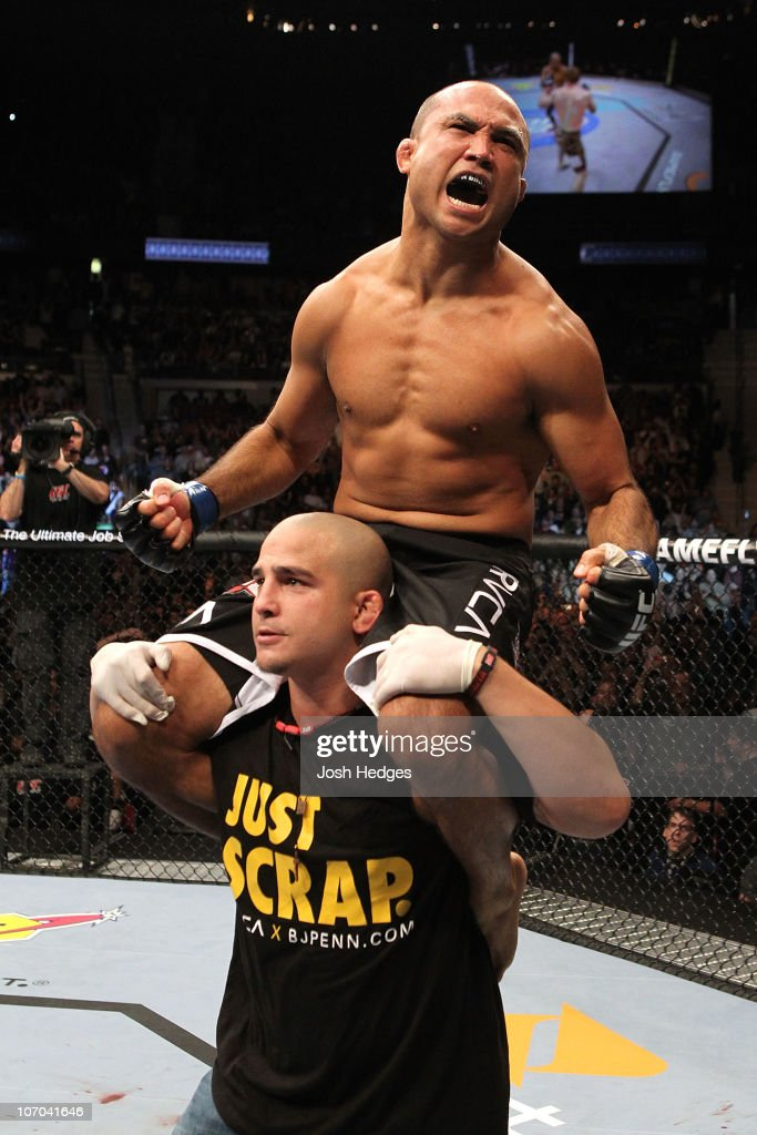 Penn celebrates after he won in the first round by knockout against Matt Hughes during their Welterweight bout part of UFC 123 at the Palace of...