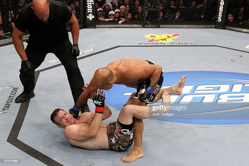 BJ Penn (black trunks/Blue Gloves) fights against Matt Hughes (red gloves) during their Welterweight bout part of UFC 123 at the Palace of Auburn Hills on November 20, 2010 in Auburn Hills, Michigan.