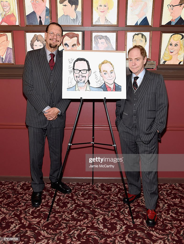 Penn Jillette and Teller pose with their Sardi's Caricatures at Sardi's on July 1 2015 in New York City