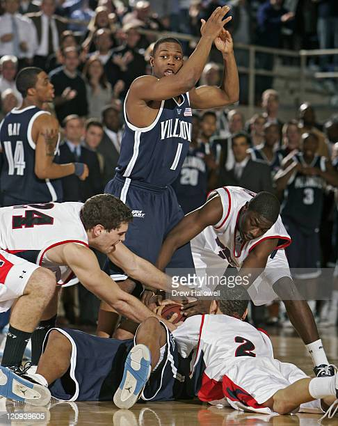 Penn Quakers Mark Zoller Ibrahim Jaaber and David Whitehurst fight for the ball with Villanova guard Randy Foye while Kyle Lowry tries to call a...