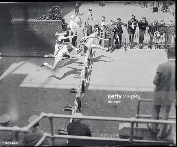 Penn Relay Games at Franklin Field Philadelphia The above photo shows Beatty of Michigan Normal as he won the 1st heat of the 400 metre hurdles at...