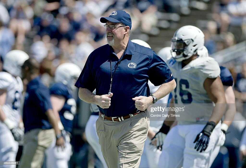 Penn State assistant coach Dwight Galt runs onto the field with the team to stretch before the Blue-White spring football game on Saturday, April 12, 2014, at Beaver Stadium in University Park, Pa.