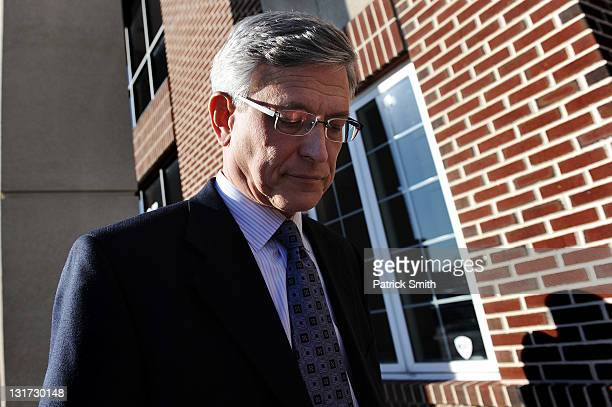 Penn State athletic director Tim Curley walks out of the Magisterial District Court after being arraigned on charges of perjury and failure to report...