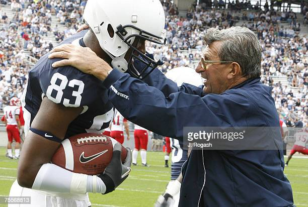 Penn State coach Joe Paterno left with Kevin Cousins before a game between Penn State and Youngstown State at Beaver Stadium Saturday September 16 at...