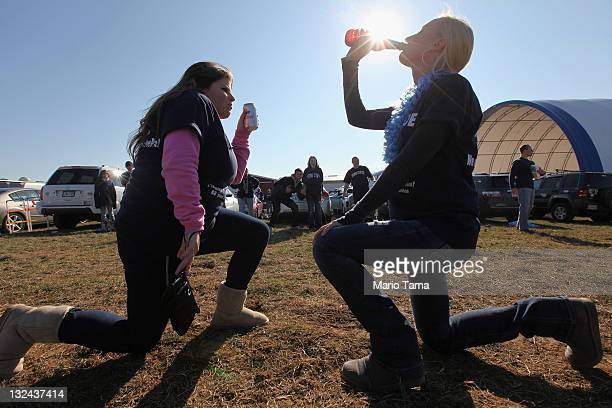Penn State fans drink at a tailgate party outside Beaver Stadium before the start of the NCAA football game between Penn State and Nebraska in the...