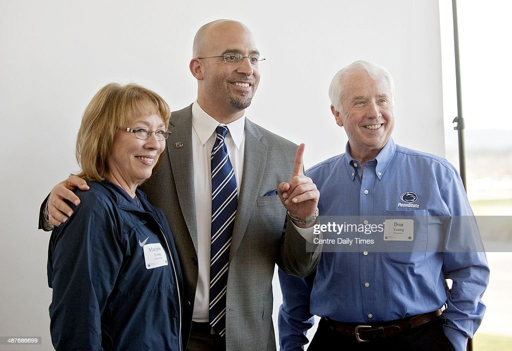 Penn State football coach James Franklin, center, poses for photos with alumni and fans during the Coaches Caravan at Pegula Ice Arena in State College, Pa., Thursday, May 1, 2014.