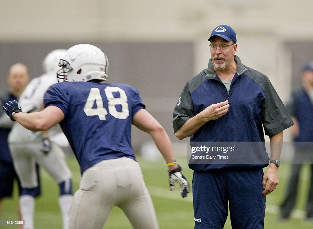 Penn State football's Dwight Galt, Director of Performance Enhancement, instructs linebacker Ryan Ammerman during spring practice in Holuba Hall in State College, Pa., Saturday, March 29, 2014.
