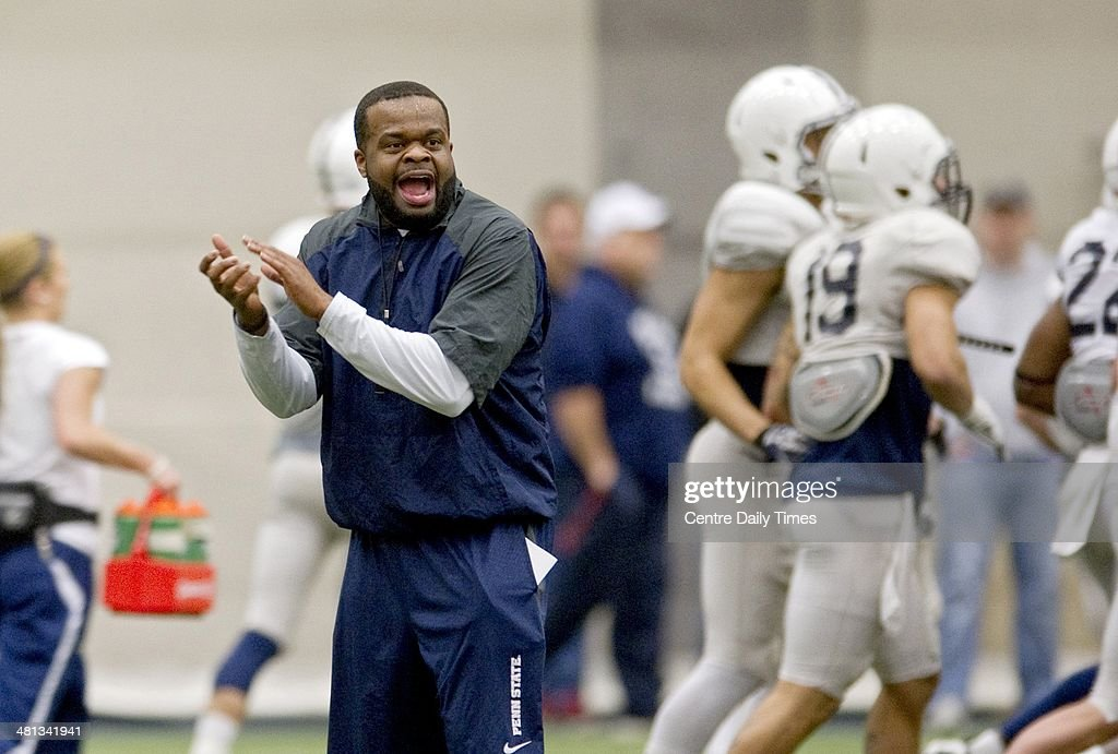 Penn State football's special teams coordinator and running backs coach Charles Huff yells to the players during spring practice in State College, Pa., Saturday, March 29, 2014.