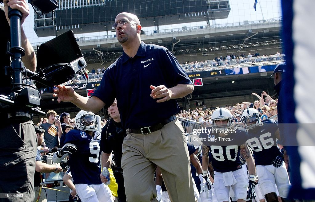 Penn State head coach James Franklin runs out of the tunnel ahead of the team for the Blue-White spring football game on Saturday, April 12, 2014, at Beaver Stadium in University Park, Pa.