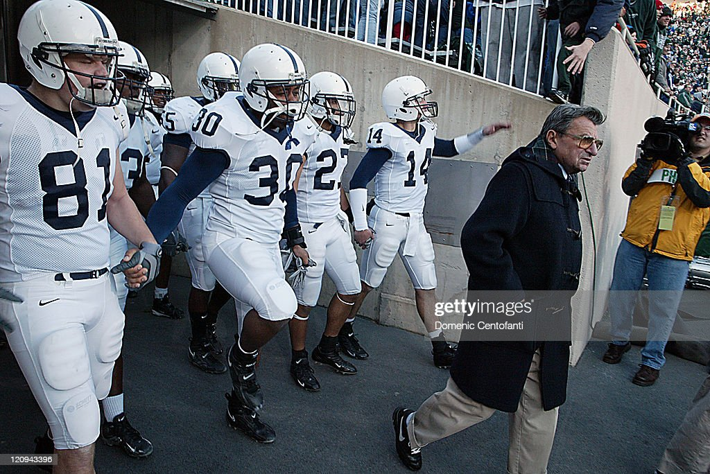 Penn State head coach <a gi-track='captionPersonalityLinkClicked' href=/galleries/search?phrase=Joe+Paterno&family=editorial&specificpeople=623059 ng-click='$event.stopPropagation()'>Joe Paterno</a> leads his team onto the field in East Lansing. Penn State won its second Big Ten title with a 31-22 victory over MSU in East Lansing Saturday, November 19, 2005.