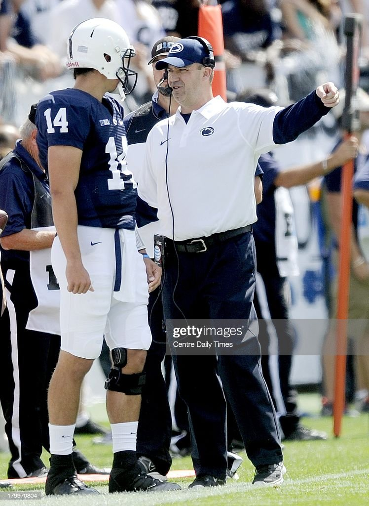 Penn State head football coach Bill O'Brien talks to quarterback Christian Hackenberg (14) in the first quarter against Eastern Michigan at Beaver Stadium in University Park, Pennsylvania, on Saturday, September 7, 2013. Penn State overwhelmed the Eagles, 45-7.