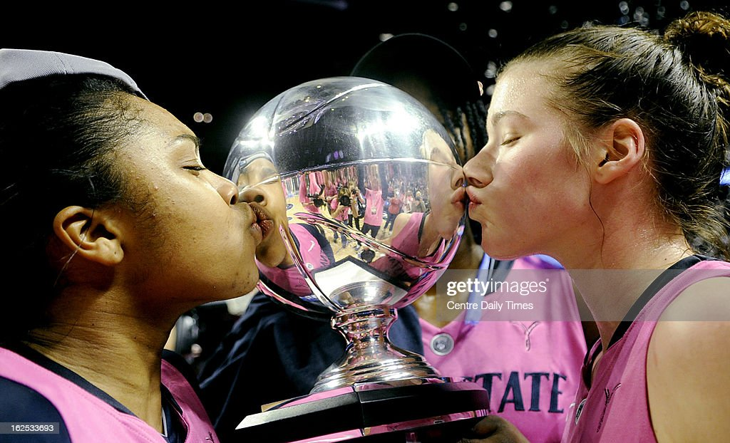Penn State Lady Lions' Alex Bentely and Maggie Lucas kiss the Big Ten trophy after a 68-57 win over Michigan in State College, Pennsylvania, Sunday, February 24, 2013.