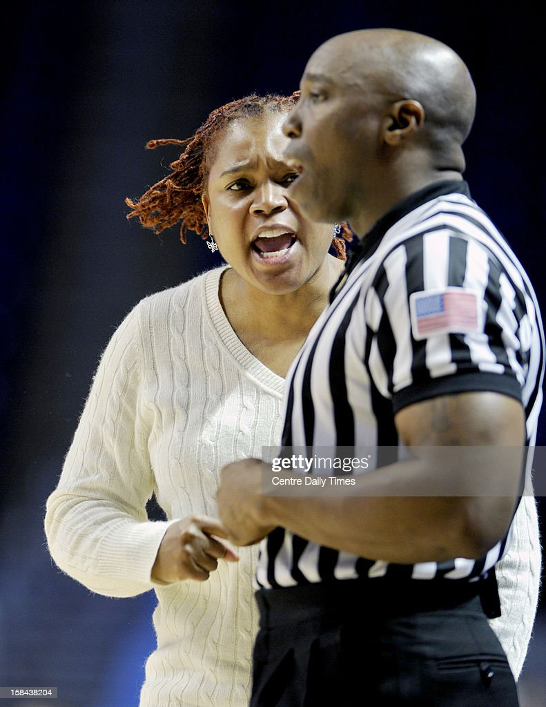 Penn State Lady Lions coach Coquese Washington yells at the officail Kevin Dillard about a call during the game against South Dakota State at the Bryce Jordan Center in State College, Pennsylvania, Sunday, December 16, 2012. Penn State beat South Dakota State, 60-50.