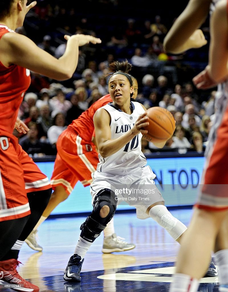 Penn State Lady Lions' Keke Sevillian looks for an open teammate to pass to among Ohio State defenders during a women's college basketball game at the Bryce Jordan Center in College Station, Pa., on Thursday, Jan. 16, 2014. The Lady Lions won, 66-42.