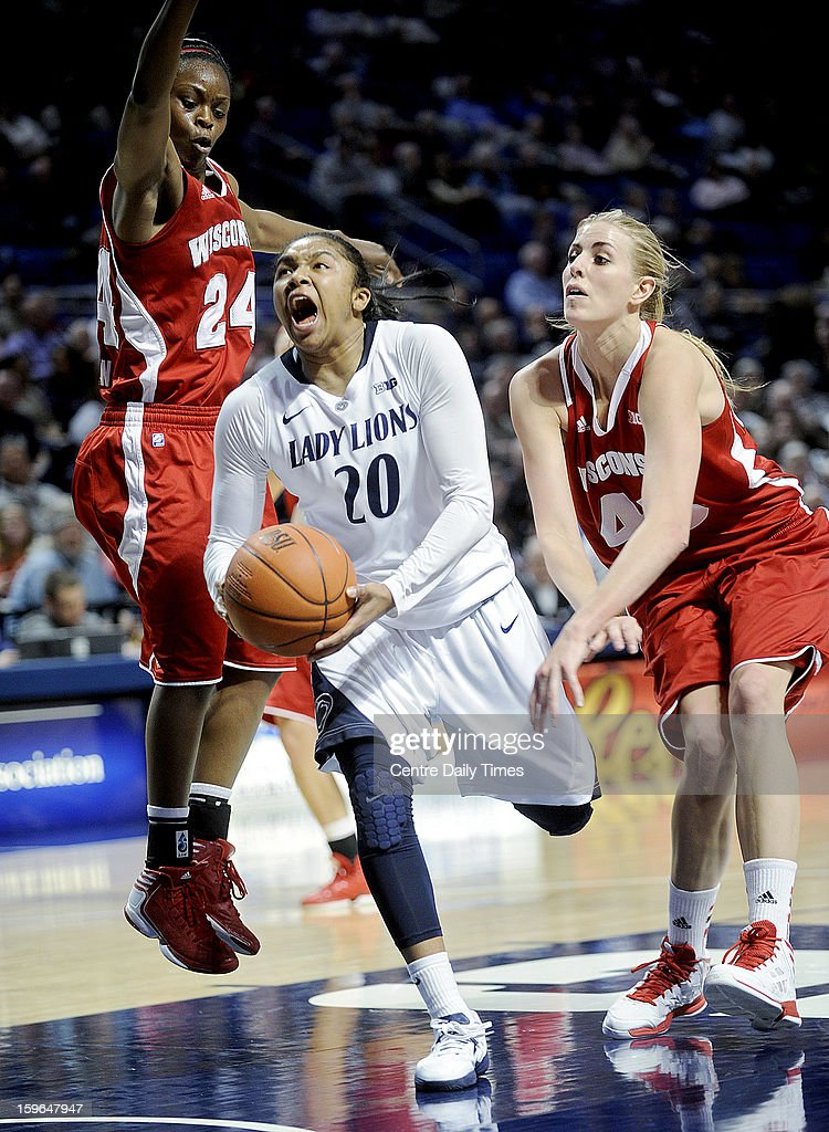Penn State Nittany Lions' Alex Bentley cuts between Wisconsin Badgers' Tiera Stephen and Cassie Rochel at the Bryce Jordan Center on Thursday, January 17, 2013, in State College, Pennsylvania.