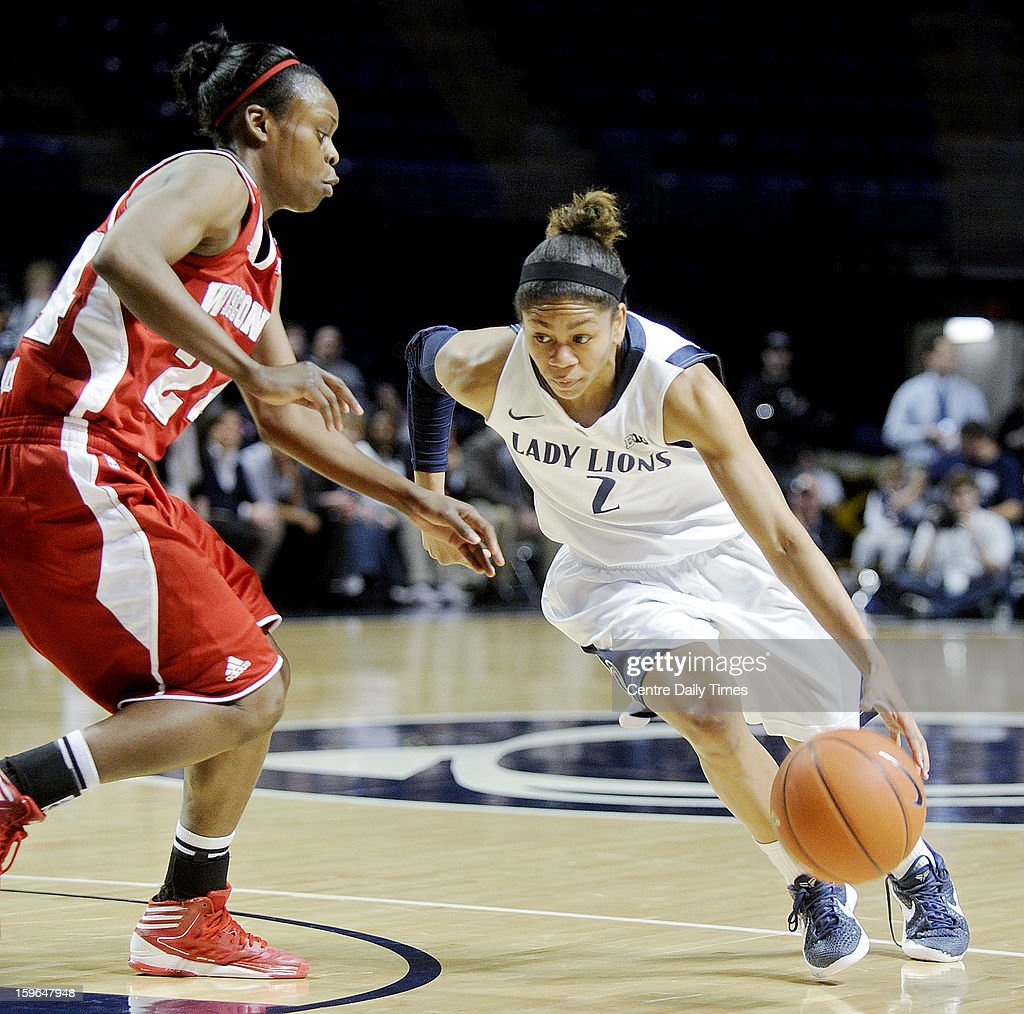 Penn State Nittany Lions' Dara Taylor dribbles around Wisconsin Badgers' Tiera Stephen at the Bryce Jordan Center on Thursday, January 17, 2013, in State College, Pennsylvania.