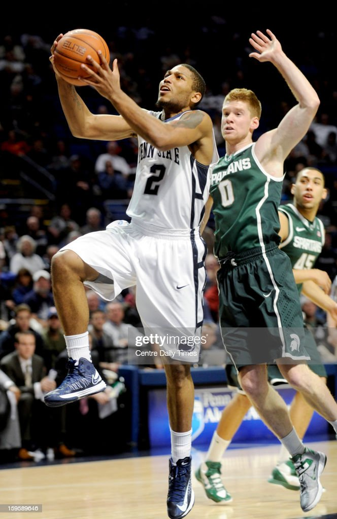 Penn State Nittany Lions' D.J. Newbill goes up for a basket past Michigan State Spartans' Russell Byrd during a men's college basketball game at the Bryce Jordan Center on Wednesday, January 16, 2013, in State College, Pennsylvania. The Spartans won, 81-72.