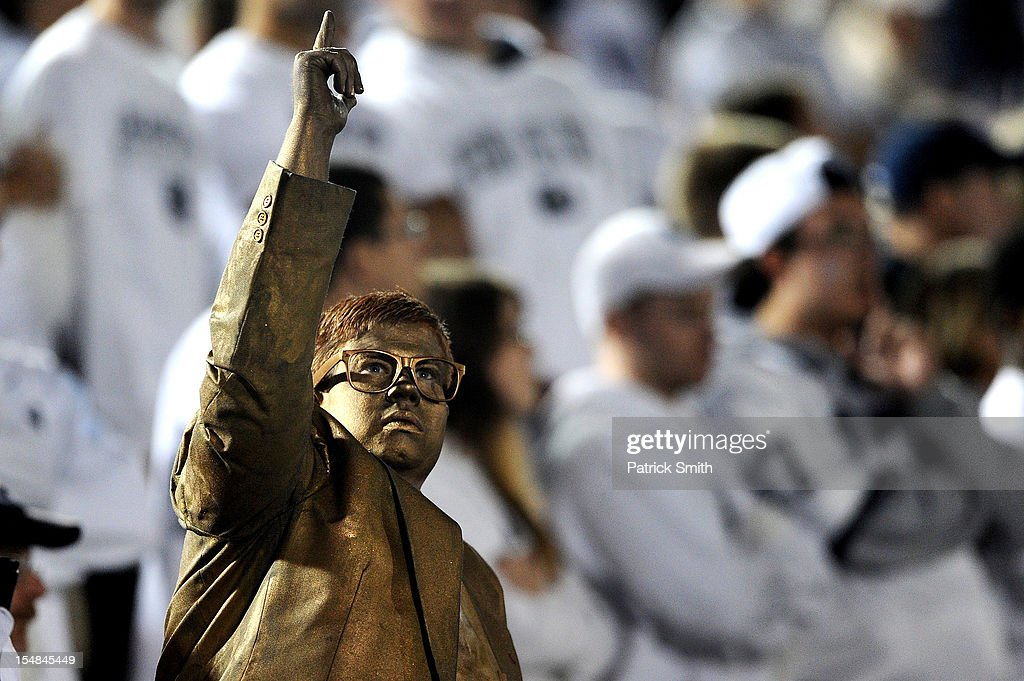 A Penn State Nittany Lions fan dressed up as former Penn State football coach Joe Paterno's statue poses to other fans in the crowd during a game against the Ohio State Buckeyes at Beaver Stadium on October 27, 2012 in State College, Pennsylvania. The Ohio State Buckeyes won, 35-23.