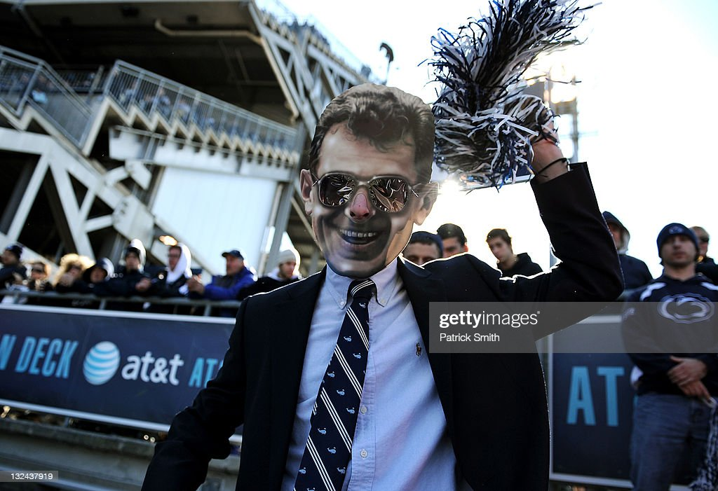 Penn State Nittany Lions fan wears a mask of former Penn State coach Joe Paterno during play against Nebraska Cornhuskers at Beaver Stadium on...