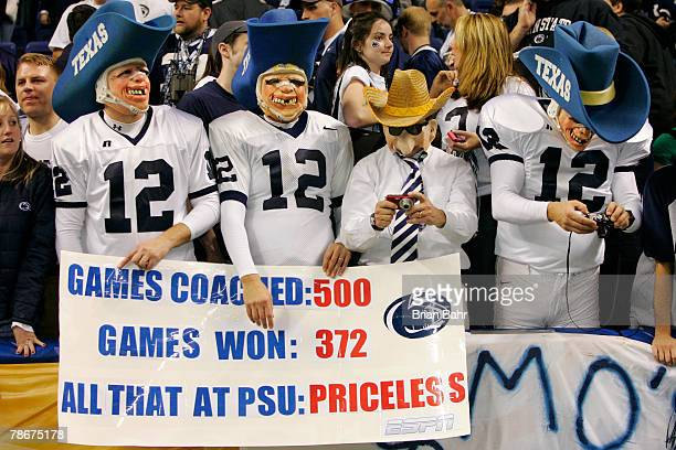 Penn State Nittany Lions fans dressed as head coach Joe Paterno while poking fun at the Texas AM Aggies 12th man tradition cheer during the Valero...