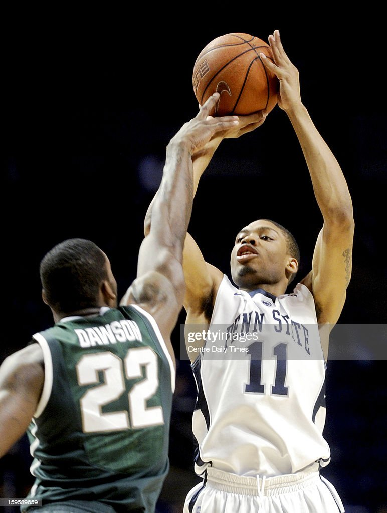 Penn State Nittany Lions' Jermaine Marshall shoots a basket over Michigan State Spartans' Branden Dawson during a men's college basketball game at the Bryce Jordan Center on Wednesday, January 16, 2013, in State College, Pennsylvania. The Spartans won, 81-72.