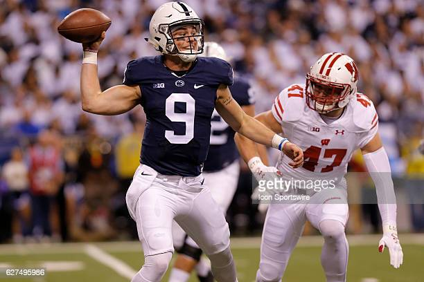 Penn State Nittany Lions quarterback Trace McSorley looks to make the pass under pressure from Wisconsin Badgers outside linebacker Vince  Biegel...