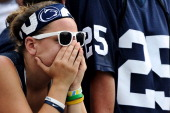 Penn State Nittany Lions react after losing to the Ohio Bobcats at Beaver Stadium on September 1 2012 in State College Pennsylvania The Bobcats won...