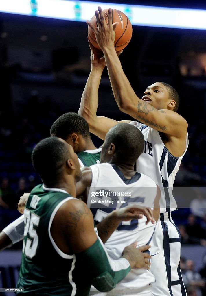 Penn State Nittany Lions's Jermaine Marshall takes a shot over Michigan State Spartans defenders during a men's college basketball game at the Bryce Jordan Center on Wednesday, January 16, 2013, in State College, Pennsylvania. The Spartans won, 81-72.