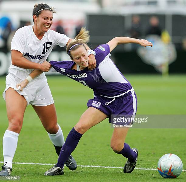 Penn State player Lindsay Bach jerks Portland's Megan Rapinoe away from the ball during the 2005 NCAA Women's College Cup semifinal game between the...