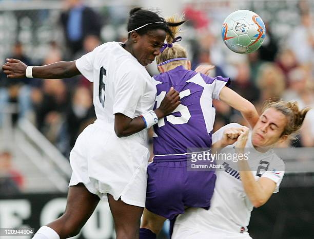 Penn State players Natalie Jacobs and Jean Rettig sandwich Portland's Natalie Budge during the 2005 NCAA Women's College Cup semifinal game between...