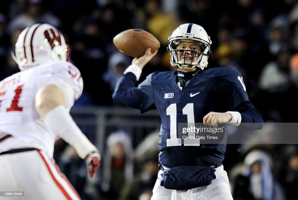 Penn State quarterback Matt McGloin (11) throws a pass against Wisconsin on Saturday, November 24, 2012, at Beaver Stadium in University Park, Pennsylvania. Penn State won in OT, 24-21.