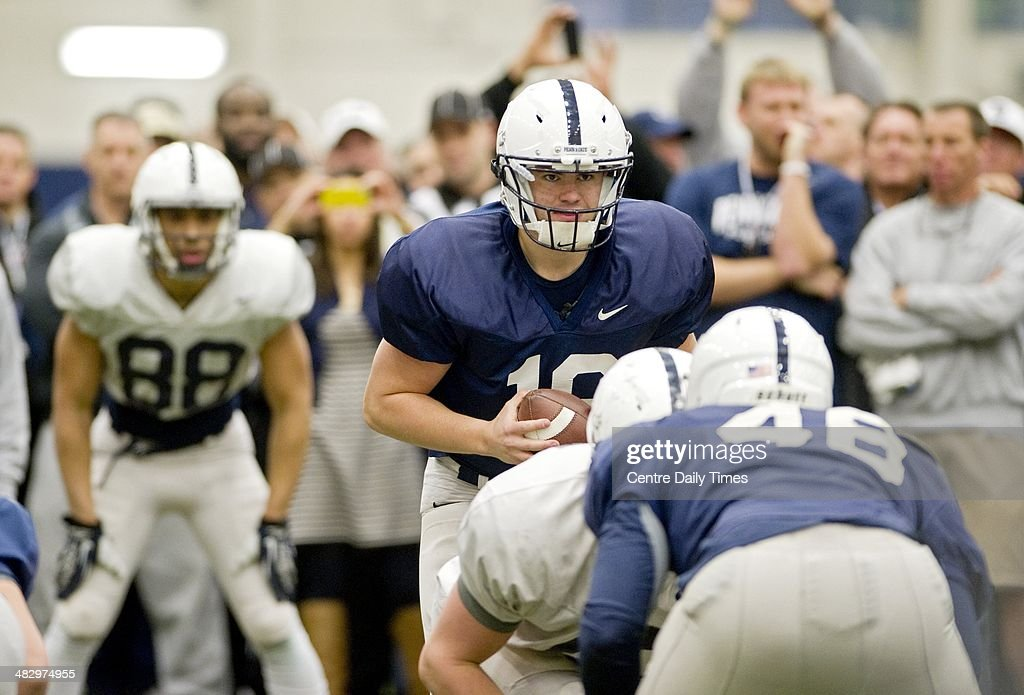 Penn State quaterback Austin Whipple prepares to run a drill during spring practice on Saturday, April 5, 2014, at Holuba Hall in University Park, Pa.