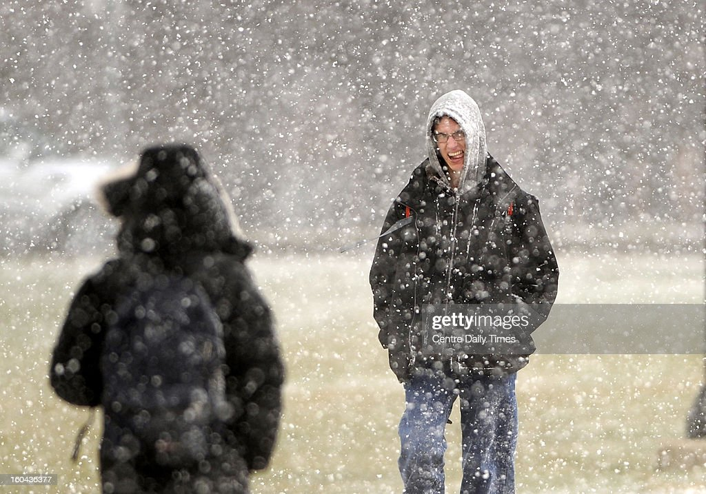 Penn State senior Mike Hricik fights the wind and snow as she walks along Bigler Road, on the Penn State campus, Thursday, January 31, 2013, in State College, Pennsylvania as severe wind and heavy snow squalls moved through Centre County.