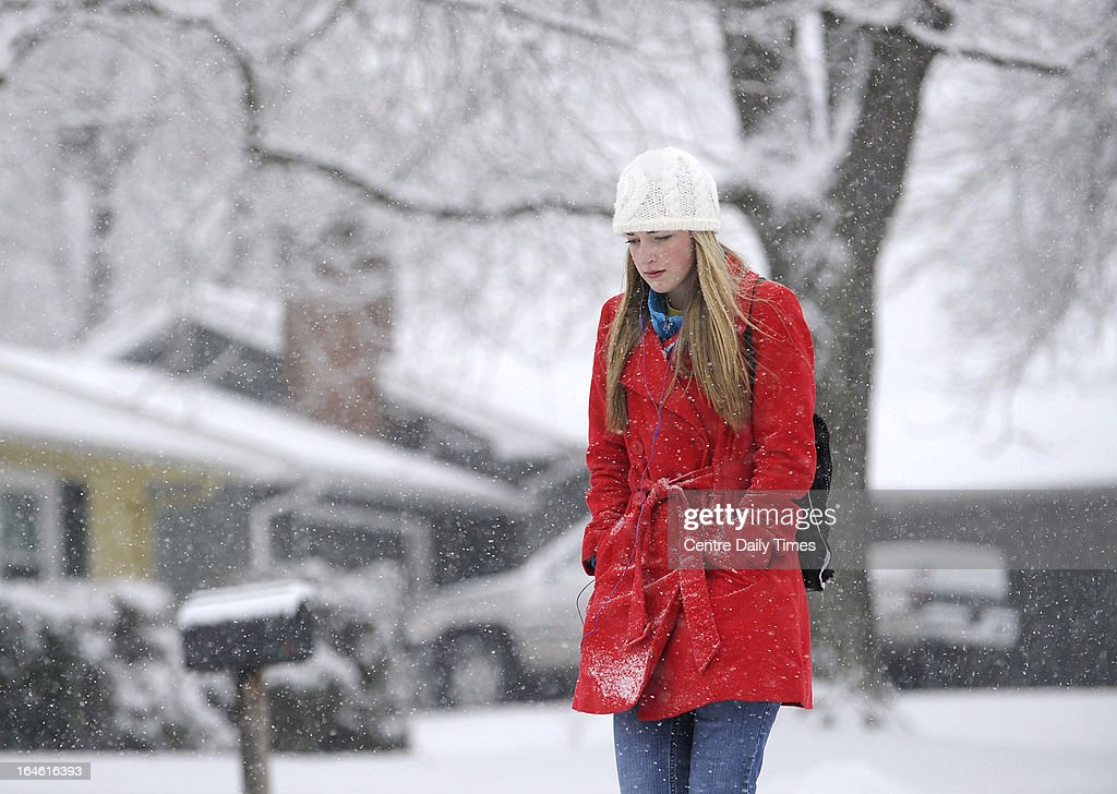 Penn State student Katy Kober walks along Curtin Street, in State College, Pennsylvania, on her way to campus. Heavy snow fell throughout Centre County, Monday, March 25, 2013, causing local schools to be closed and hazardous traveling conditions.