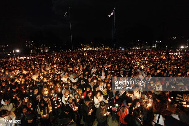 Penn State students and supporters gather for a large candelight vigil for victims of child abuse in front of Old Main in the wake of the Jerry...