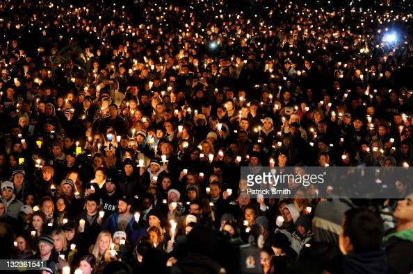 Penn State students hold a candlelight vigil for abused victims in the Penn State scandal on Old Main Lawn November 11 2011 in State College...
