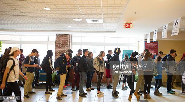 Penn State students stand in line inside the Student Union called The Hub waiting to cast their ballots in the presidential election on November 8...