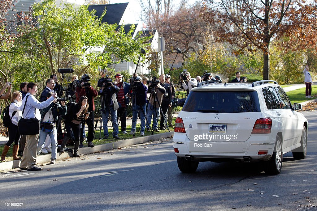 Penn State University head football coach Joe Paterno leaves his house in a vehicle on November 9, 2011 in State College, Pennsylvania.