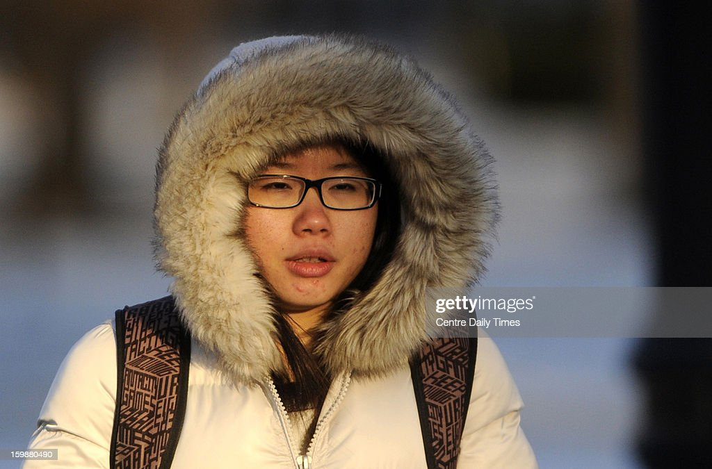Penn State University student Astrid Xiao walks through campus as she tries to say warm, Tuesday, January 22, 2013. Temperatures in State College, Pennsylvania were in the single digits with wind chills in the negative numbers.