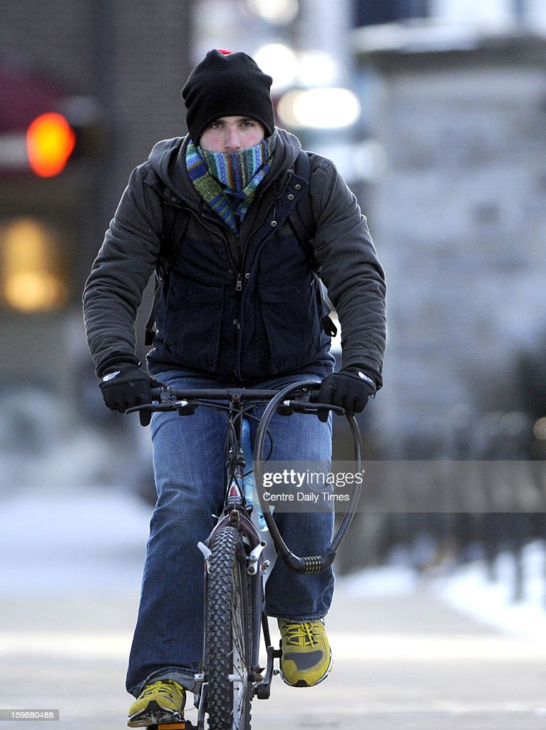 Penn State University student Ben Sepe tries to stay warm as he rides his bike to class, Tuesday, January 22, 2013. Temperatures in State College, Pennsylvania were in the single digits with wind chills in the negative numbers.