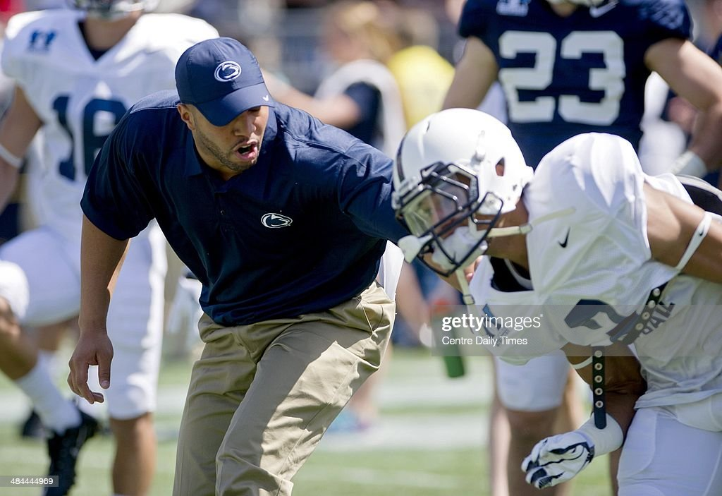 Penn State wide receivers coach Josh Gattis runs a drill with players as they warm up for during the Blue-White spring football game on Saturday, April 12, 2014, at Beaver Stadium in University Park, Pa.