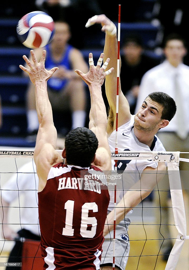 Penn State's Aaron Russell spikes the ball over Harvard's Nick Madden (16) during the EIVA Championship game on Saturday, April 27, 2013, at Rec Hall in University Park, Pennsylvania. Penn State won the match, 25-16, 25-16, 25-16.