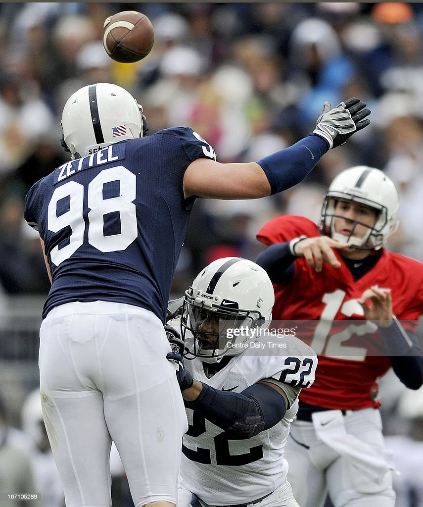 Penn State's Akeel Lynch (22) blocks Anthony Zettel (98) as quarterback Steven Bench (12) makes a pass during the team's spring scrimmage at Beaver Stadium in University Park, Pennsylvania, on Saturday, April 20, 2013.