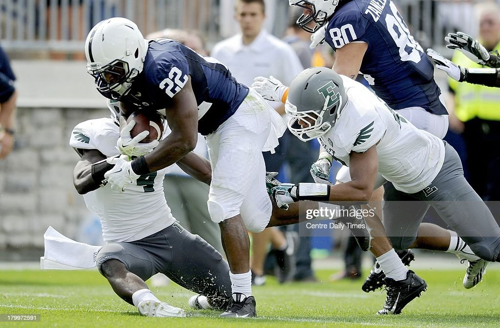 Penn State's Akeel Lynch (22) dives into the end zone for an 18-yard touchdown in the fourth quarter against Eastern Michigan at Beaver Stadium in University Park, Pennsylvania, on Saturday, September 7, 2013. Penn State overwhelmed the Eagles, 45-7.